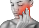 A woman experiencing tooth pain in Surprise AZ