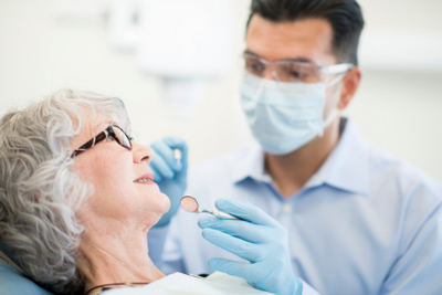 An elderly woman about to receive an oral biopsy.